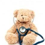 Teddy bear with a stethoscope — Stock Photo #14078960