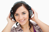 Blue eyed woman wearing headphones — Stock Photo