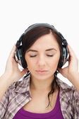 Woman with headphones enjoying music the eyes closed — Stock Photo
