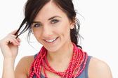 Smiling blue eyed woman with a red bead necklace — Photo