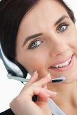 Vacker affärskvinna med ett headset — Stockfoto