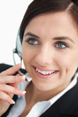 Happy businesswoman using a headset — Stock Photo