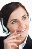 Pretty businesswoman using a headset — Stock Photo