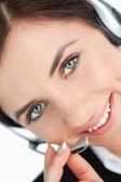 Green eyed kvinna med headset — Stockfoto