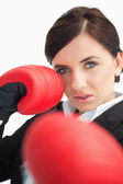 Beautiful woman boxing with red gloves — Stock Photo
