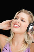 Joyful blonde woman listening to music — Stock Photo