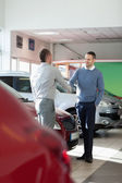 Salesman shaking hand to a customer — Stock Photo