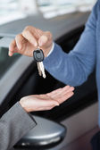 Man giving keys to a woman — Stock Photo