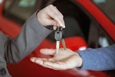 Person handing keys to someone else — Stock Photo