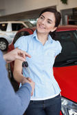 Smiling woman shaking the hand of a man — Stock Photo