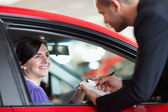 Woman in a car talking with a salesman — Stock Photo