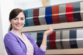 Woman while pointing a color palette — Stock Photo