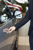 Man holding a car door handles — Stock Photo