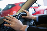 Man holding a steering wheel — Stock Photo