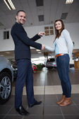 Man shaking hand with woman — Stock Photo