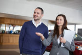 Woman showing something to a man — Stock Photo