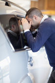 Customer looking inside a car — Stock Photo