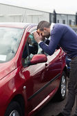 Man looking through the window of the car — Stock Photo