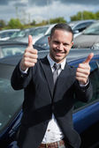 Businessman raising his thumbs while smiling — Stock Photo