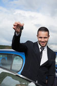 Happy man holding car keys — Stock Photo