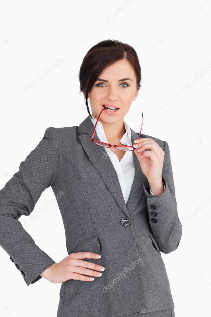 Seductive business woman putting her glasses in her mouth against white backgorund — Stock Photo #14071789
