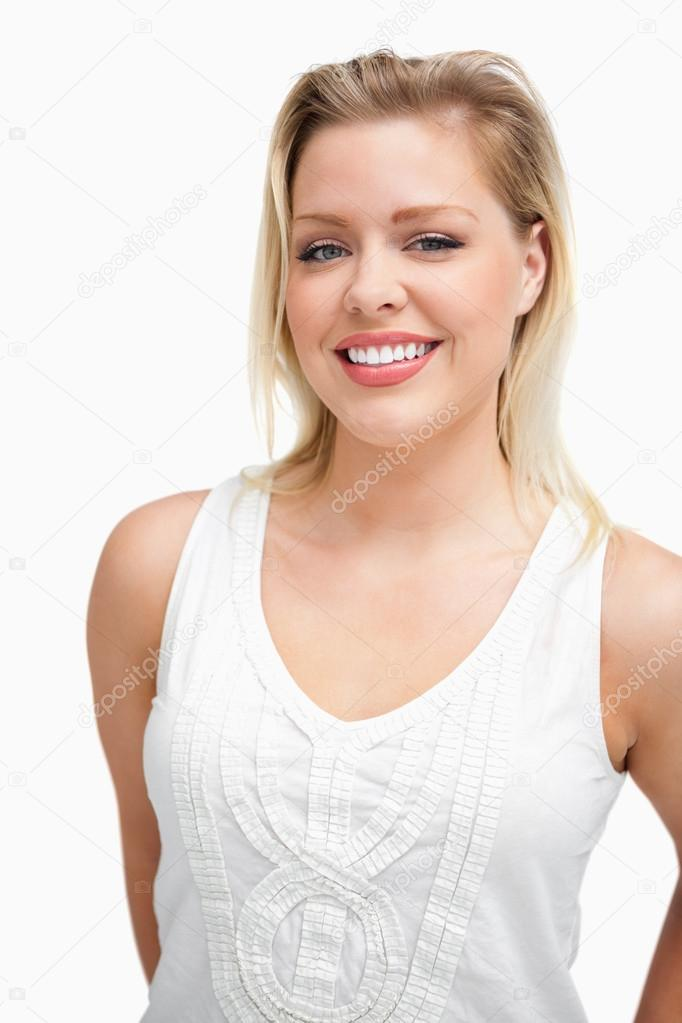 Joyful blonde woman standing upright against a white background — Stock Photo #14072532