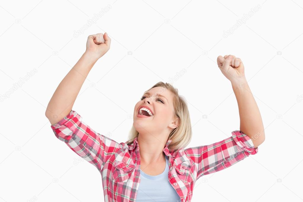 Happy woman raising her two fists against a white background — Stock Photo #14073159
