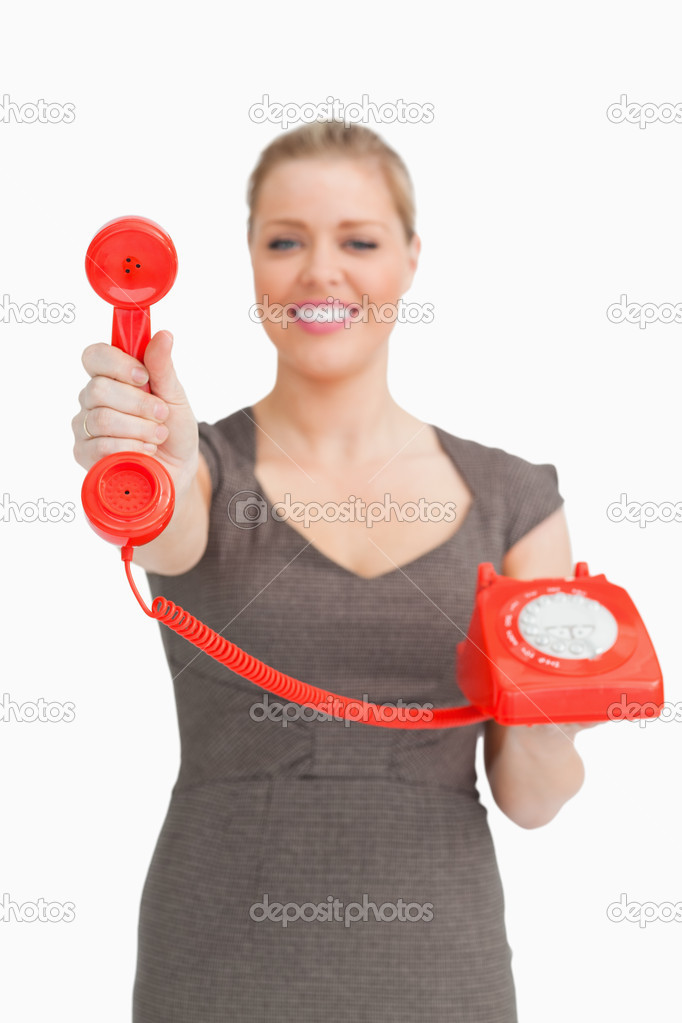 Woman showing a retro phone against a white background — Stock Photo #14076598