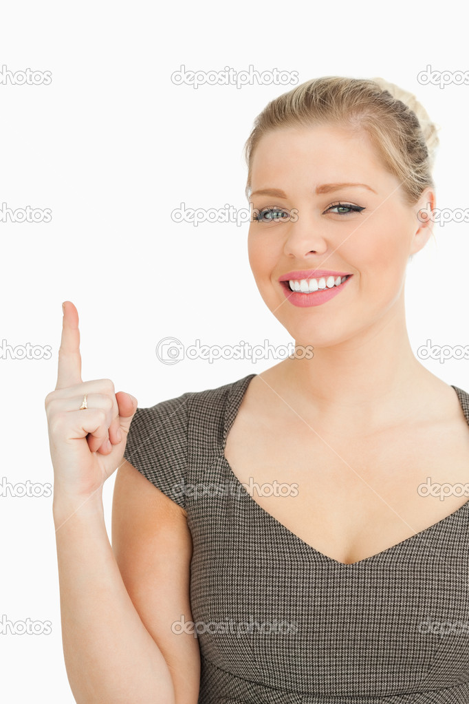 Pretty woman pointing something with her finger against white background — Stock Photo #14077070