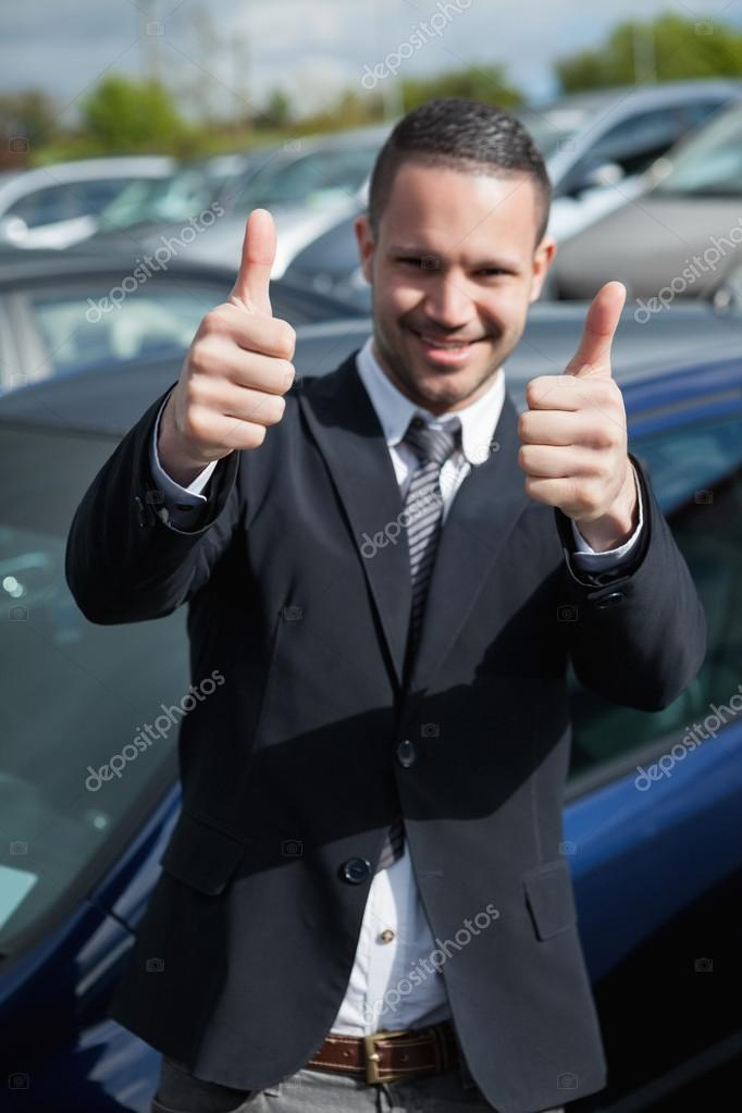 Happy man raising his thumbs outdoors — Stock Photo #14078445