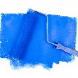 Paint roller on blue traces — Stock Photo