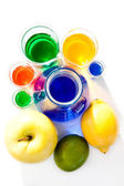 Fruits and beakers — Stock Photo