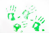 Four green handprints — 图库照片
