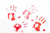 Four red handprints — 图库照片