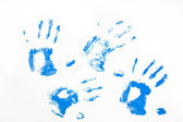 Four blue handprints — 图库照片