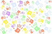 Lots of multi colored handprints — Stock Photo