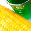 Beaker next to corn — Stock Photo