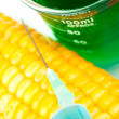 Corn next to a beaker - Stock Photo