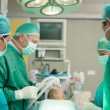 Surgical team working together — Stock Photo