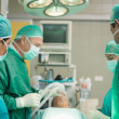Stock Photo: Surgical team working together