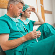 Stock Photo: Surgeons waiting in corridor