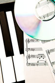 Cd and music score — Stock Photo