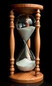 Sand flowing inside of hourglass — Stock Photo