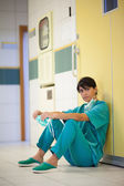 Surgeon sitting on the floor — Stock Photo