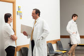 Doctors and a patient talking — Stock Photo