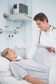 Doctor speaking to his patient — Stock Photo