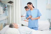 Nurse smiling to a patient — Stock Photo
