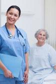 Smiling nurse holding a folder — Stock Photo
