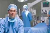 Practitioner next to operating table — Stock Photo