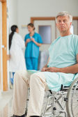 Patient in a wheelchair looking at camera — Stock Photo